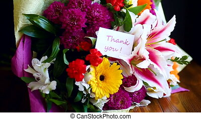 beautiful bouquet of different flowers on a wooden table