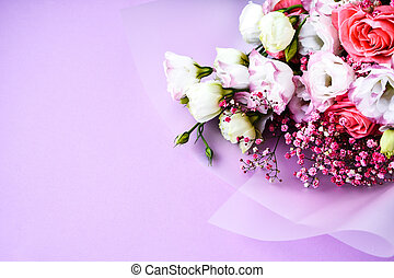 Beautiful bouquet of different flowers on purple background. Copy space for text. Holiday greeting card