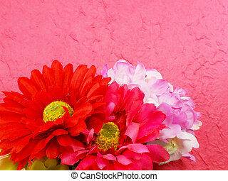 beautiful bouquet of fake gerbera on pink background