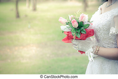 Beautiful bouquet of flowers in hand the bride.