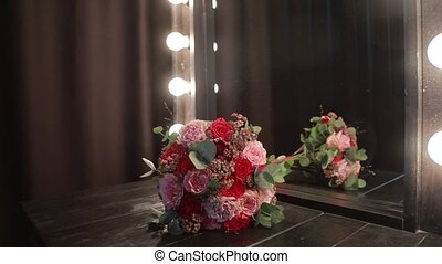 beautiful bouquet of flowers on a dark table with lights