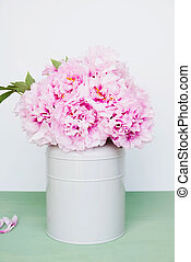 Beautiful bouquet of fresh pink peony flowers in full bloom.