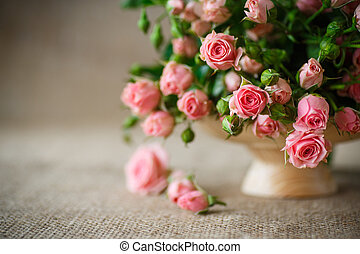 pink roses - beautiful bouquet of pink roses on an old table...