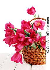 tulips in a wicker basket