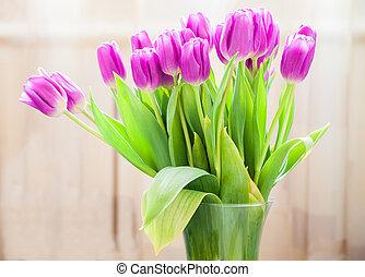 purple tulips in a vase
