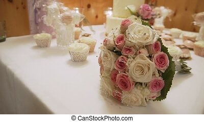 Beautiful bouquet of roses on the wedding table in a luxury...