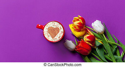 Beautiful bouquet of tulips and cappuccino
