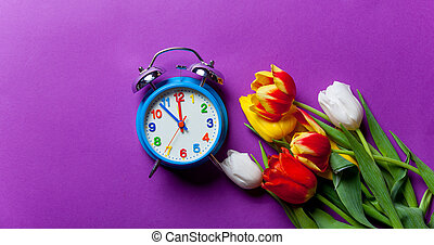 Beautiful bouquet of tulips and clock