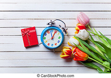 bouquet of tulips and clock