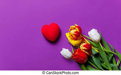 Beautiful bouquet of tulips and gift