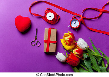 Beautiful bouquet of tulips and gifts