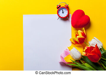 Beautiful bouquet of tulips and paper