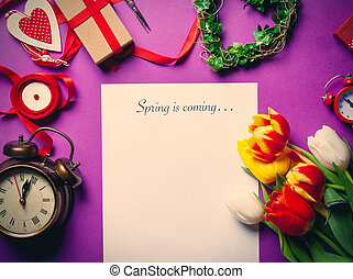 tulips and paper with words Spring is coming