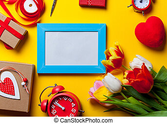 bouquet of tulips and photo frame with others