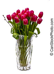 Beautiful bouquet of tulips in crystal on a white background