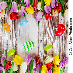 Beautiful bouquet of tulips with easter eggs