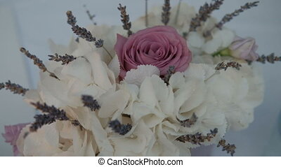 Beautiful bouquet of white hydrangeas and pink rose is in...