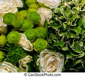 Beautiful bouquet of white roses and green flowers