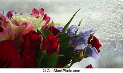 Beautiful bouquet roses, iris and alstroemeria rotates.