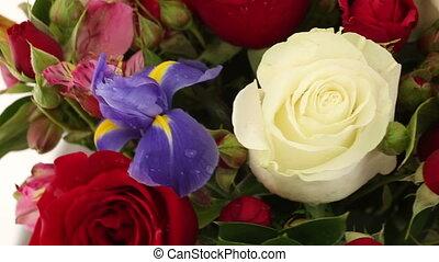Beautiful bouquet roses, iris and alstroemeria rotates. -...