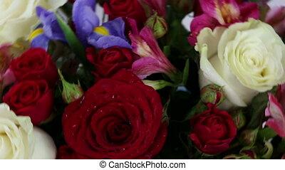 Beautiful bouquet roses, iris and alstroemeria quickly...