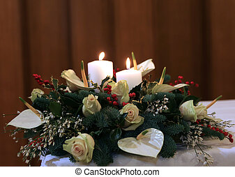 beautiful bouquet with calla lilies, white flowers and Holly on the white tablecloth