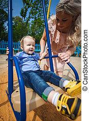 beautiful boy on swing