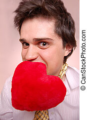 Beautiful boy with toy heart.