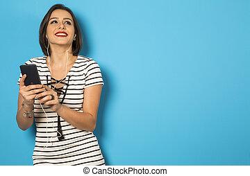 beautiful Brazilian girl enjoying music with the head phones
