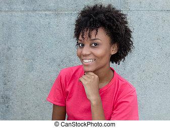 Beautiful brazilian woman in bright red shirt