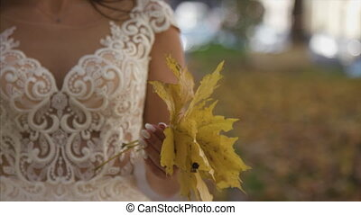 Beautiful bridal bouquet in hands of young bride dressed in...