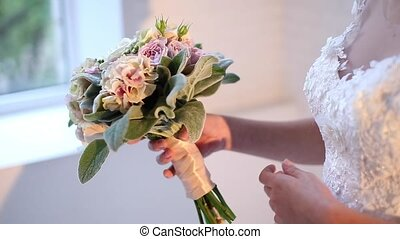 Beautiful bridal bouquet in hands of young bride