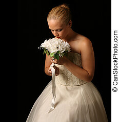Beautiful Bride Against Dramatic Black Background