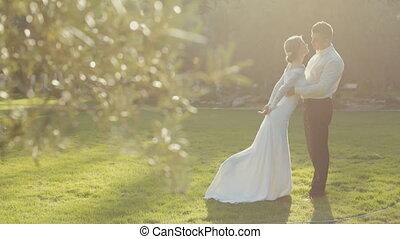 Beautiful bride circling the groom in vintage beautiful dress