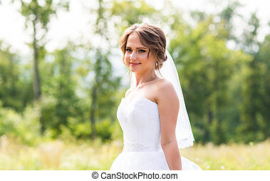 3c1f0a2f77 Beautiful smiling bride girl in wedding dress with white umbrella ...