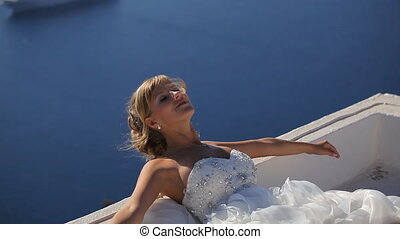 beautiful bride having fun on the background of the Aegean Sea