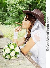 bride in a cowboy hat