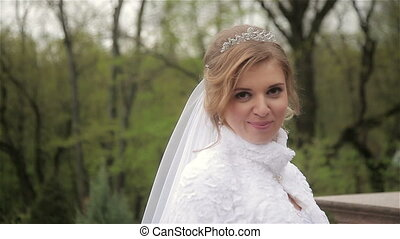 Beautiful bride in a wedding dress posing
