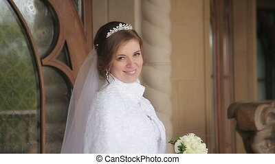 Beautiful bride in a wedding dress posing