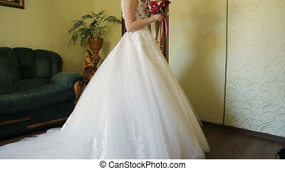 Beautiful bride in a wedding dress with bouquet