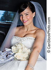 Beautiful Bride in Limo - Portrait of happy beautiful bride...