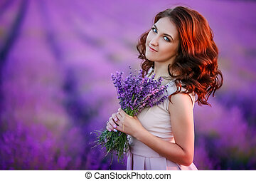 beautiful bride in luxurious wedding dress in purple lavender flowers. Fashion romantic stylish woman with violet bouquet. Alluring slim girl in sunset over lavenda waiting for groom - Provence France