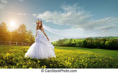 Beautiful bride in the outdoors - idyllic