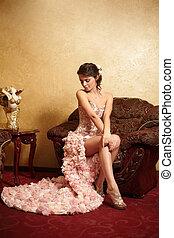 Beautiful bride in unusual wedding dress in the interior...