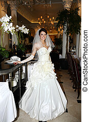 Beautiful bride in unusual wedding dress in the restaurant