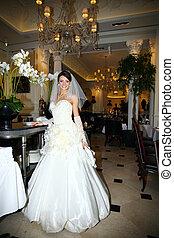Beautiful bride in unusual wedding dress in the restaurant