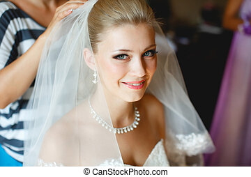 Beautiful bride is preparing for the wedding ceremony