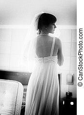 Beautiful Bride looking at mirror