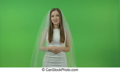Beautiful bride on a green background.