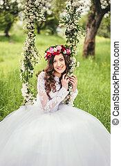 Beautiful bride on a swing